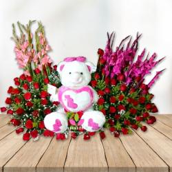 Arreglo floral con Oso