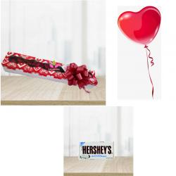 Pack:  caja de rosas, Globo en helio y  chocolatina Hersey's