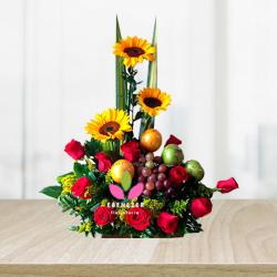 Arreglo floral con frutas en Cali